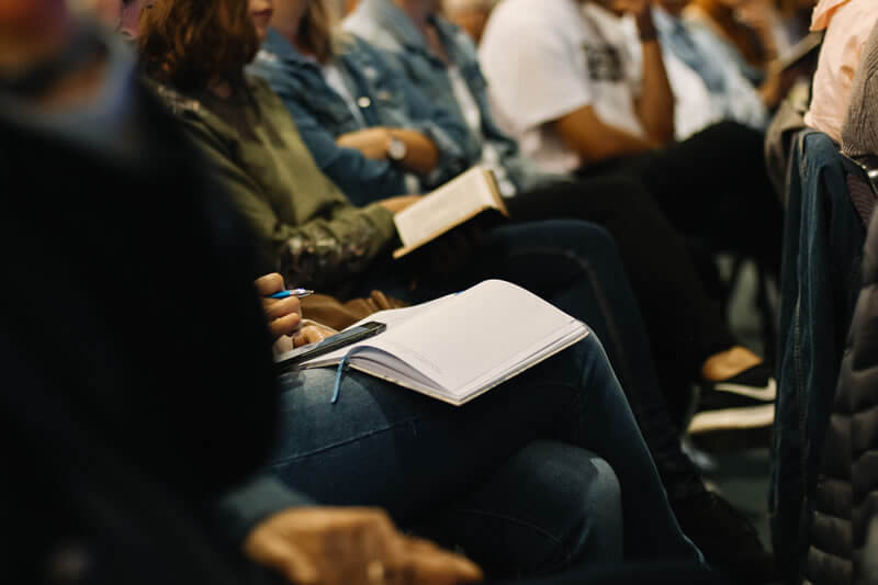 people-gathering-at-event-with-notebooks